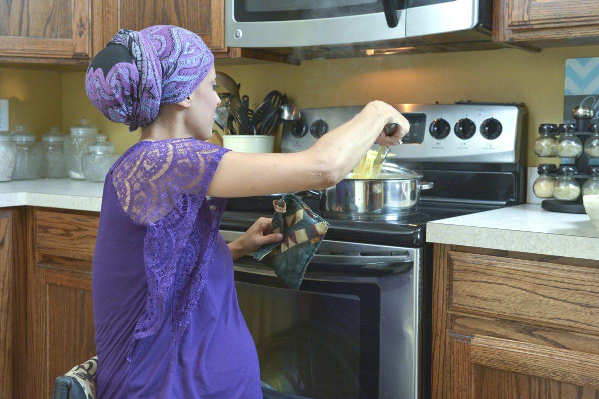 Woman in wheelchair making dinner